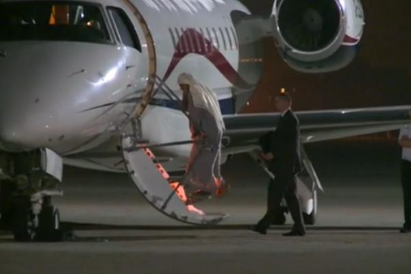 Qatada-boarding-jet.png