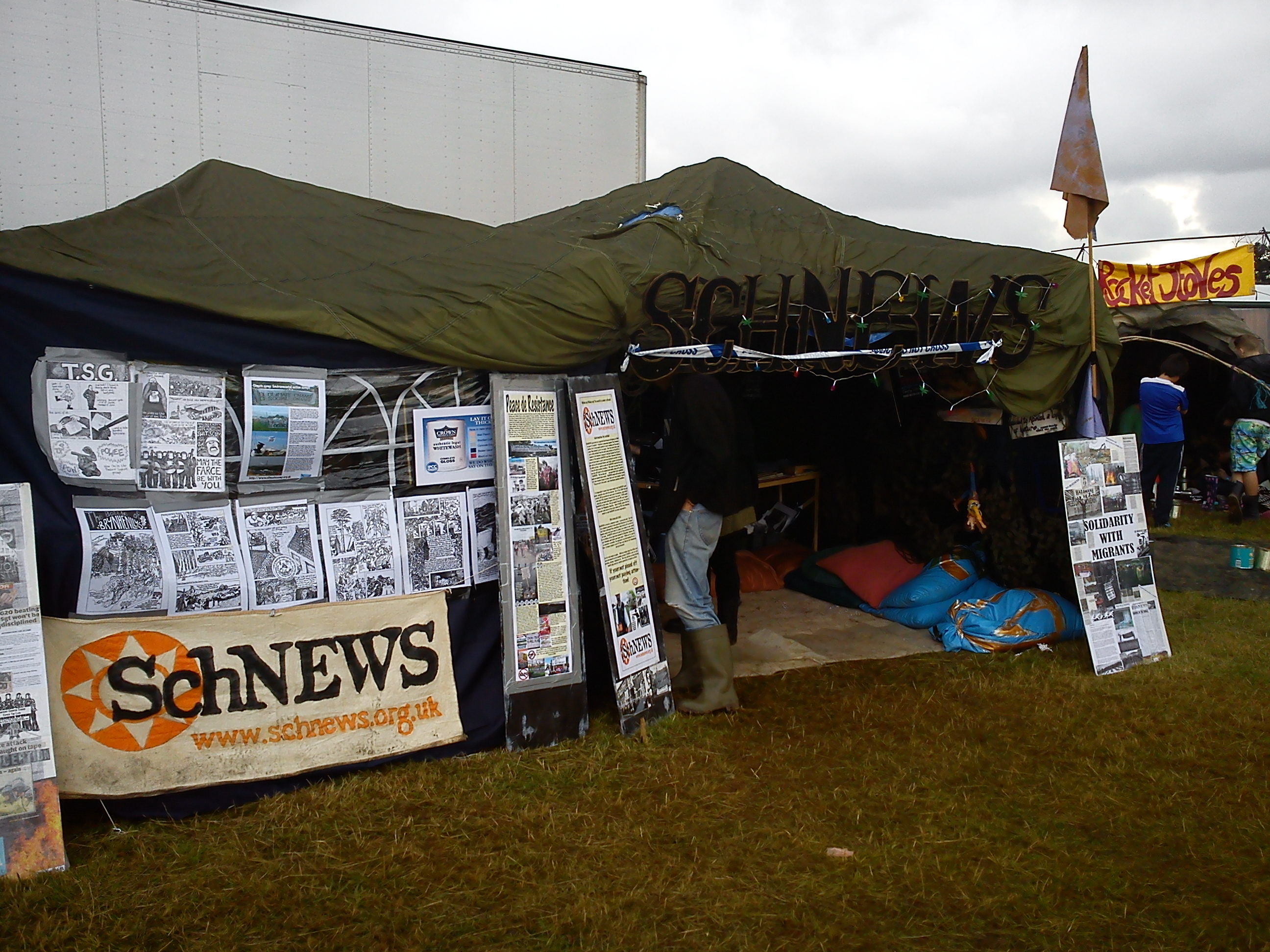 Schnews_stall_at_Boomtown_Festival.jpg